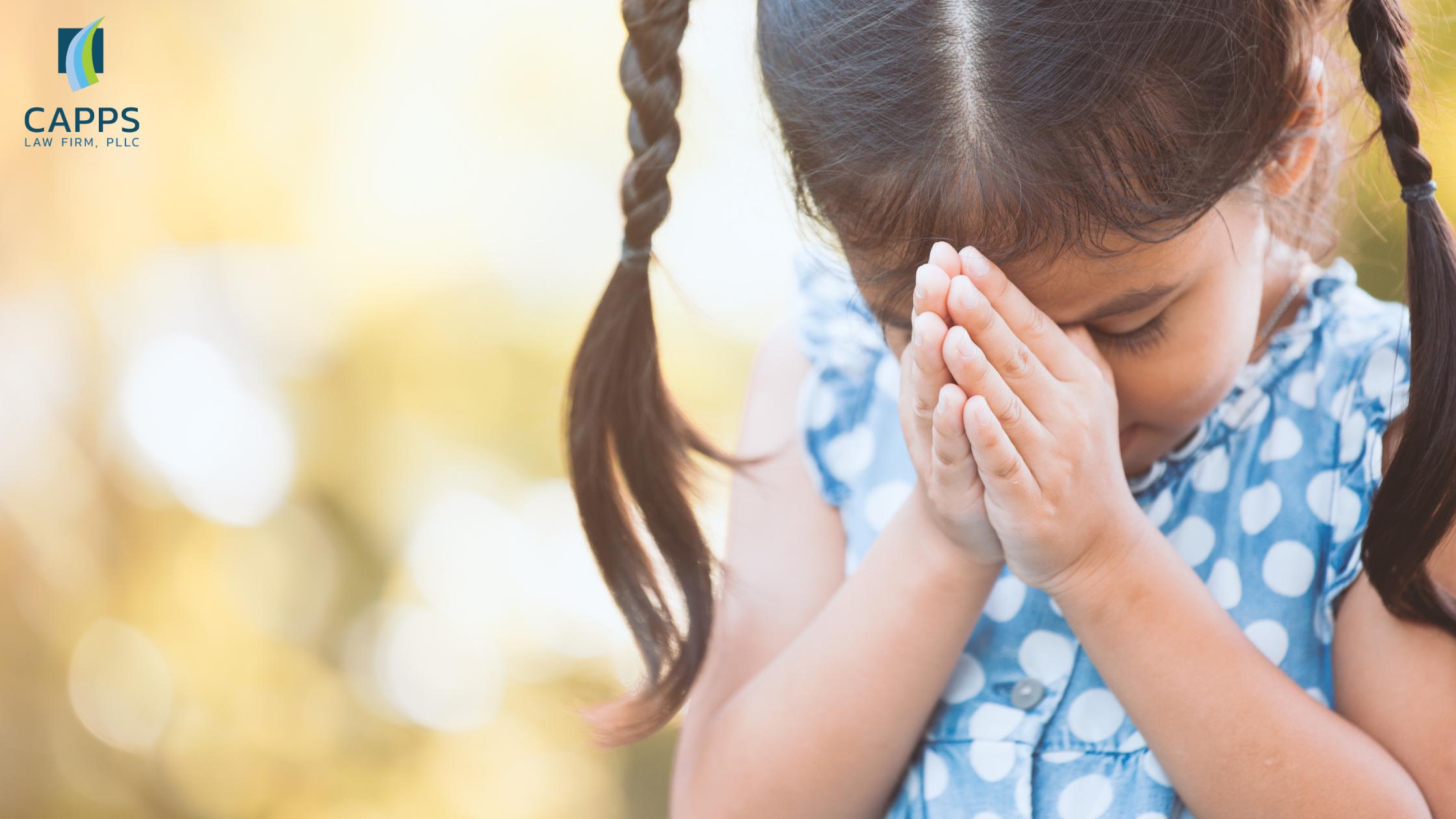 young child praying
